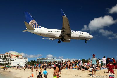 Plane directly above the beach