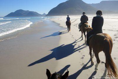 Reiten am Strand in Südafrika