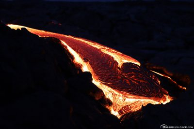 The flowing lava in Kalapana at night