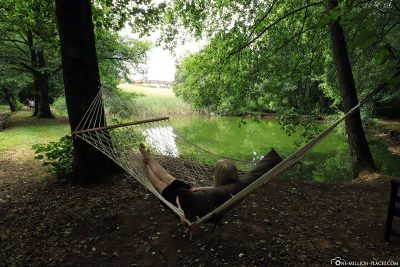 Relaxing in the hanging mats at the pond