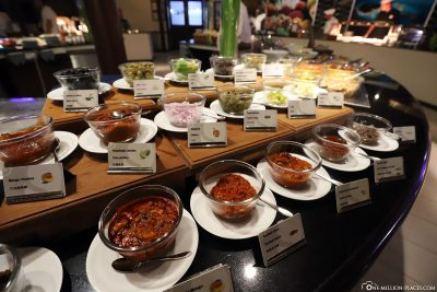 Various sauces and spices at the buffet
