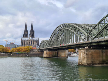 East view of Cologne Cathedral with Hohenzollern Bridge