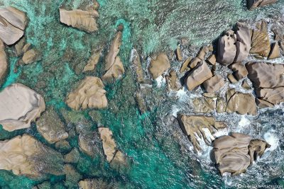 The rock formations in the water