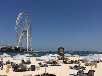 The beach overlooking the Ferris wheel